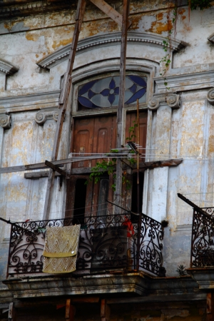 Deteriorated balcony in Havana, Cuba photo