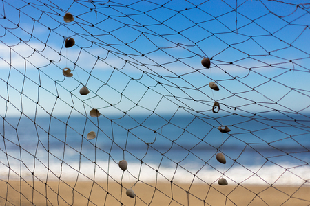 fishing net on beach, sea and sky at background photo