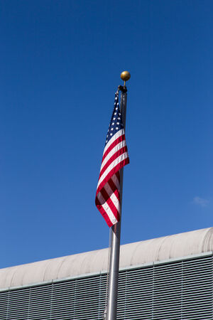 deteriorated: US flag  at airport