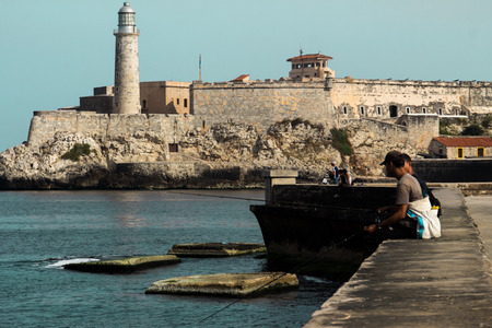 El Malecon with fishing men, La Havana photo