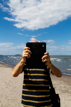 photography of a man using tablet  photo