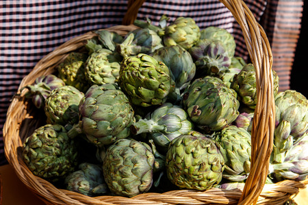 artichokes in basket Stock Photo