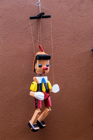 pinnochio marionette on wall