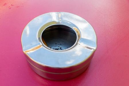 pernicious: metallic Ashtray Stock Photo