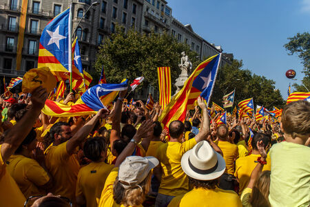 strret: BARCELONA, SPAIN - SEPT. 11: People manifesting ingependence of Scotlandon and Catalonia at the strret of Barcelona during the National Day of Catalonia on Sept. 11, 2014 in Barcelona, Spain.