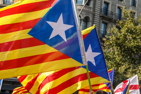 separatism: BARCELONA, SPAIN - SEPT. 11: People manifesting ingependence of Scotlandon and Catalonia at the strret of Barcelona during the National Day of Catalonia on Sept. 11, 2014 in Barcelona, Spain.