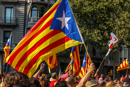 BARCELONA, SPAIN - SEPT. 11: People manifesting ingependence of Scotlandon and Catalonia at the strret of Barcelona during the National Day of Catalonia on Sept. 11, 2014 in Barcelona, Spain.