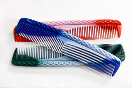long handled: three comb isolated on white background