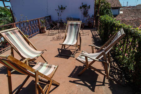 idling: chairs in terrace at sun