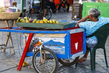 Woman Selling food in the street in Nicaragua photo