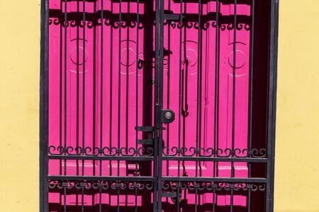 gratings: detail of purple door with black gratings