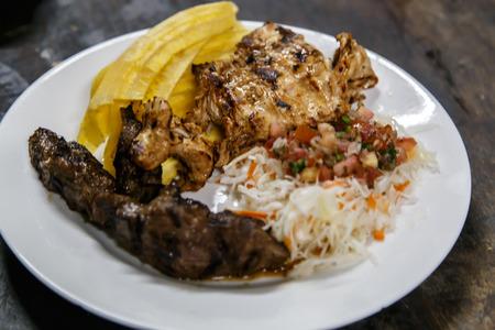 mojo: traditional nicaraguan cuisine, roast meat, salad and fried banana. Stock Photo