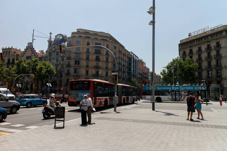 turistic: Barcelona, Catalunya- june 12th 2015: street view with turistic bus and people, La Pedrera at background