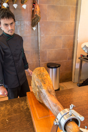 iberico: jamon iberico, spanish ham, with man