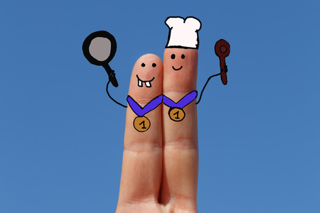 cookers, two fingers painted with sky at background Banque d'images