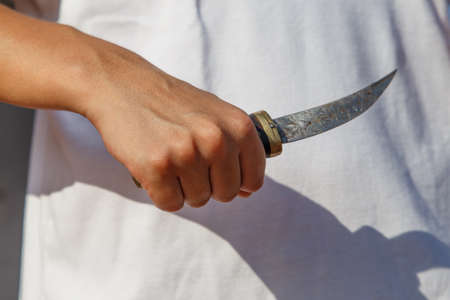 girl with knife: girl with knife at hand