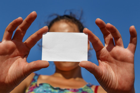 white card: girl showing an empty white card Stock Photo