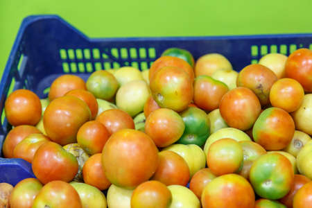 insertion: Red group of tomatoes with green insertion