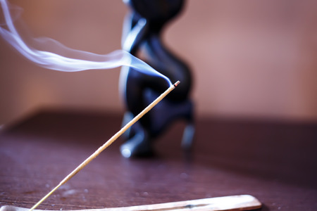 Incense stick with smoke Imagens