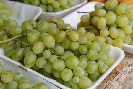 riesling: White wine grapes in a market