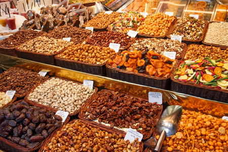 frutas secas: Dried fruit stall display in Barcelonas marketplace