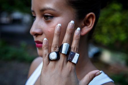 latin girl: latin girl showing handmade rings Stock Photo