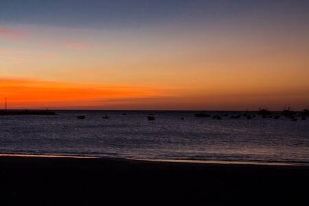 san juan: san juan del sur, nicaragua, portrait of sunset