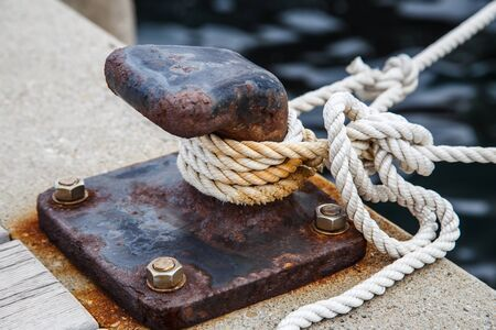 ope for mooring a vessel is adhered to a pier Stock Photo