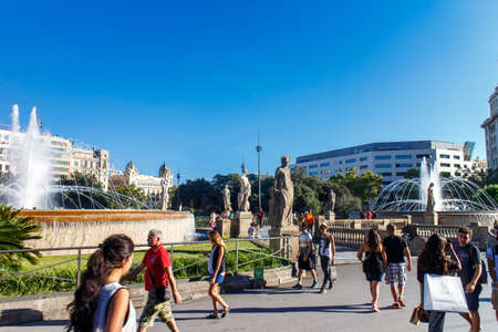 turistic: Barcelona, Catalunya, Spain - August 28, 2015: Plaza Catalunya view with people on a sunny day. Its the most turistic place in city.