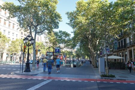 turistic: Barcelona, Spain - August 28, 2015: Passeig de gracia view with people, the most turistic street from city