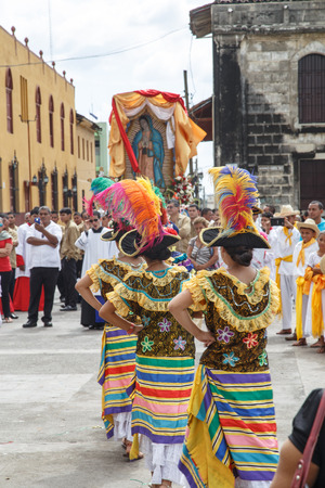 Leon, Nicaragua - December 12, 2015: Aborigen dancers in typical dress celebrating on the street