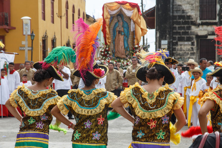 anthropologist: Leon, Nicaragua - December 12, 2015: Aborigen dancers in typical dress celebrating on the street