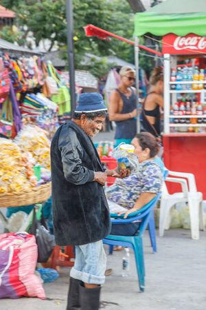 poor man: Leon, Nicaragua, - December 14, 2015: street view on the city with a poor man on tourist place Editorial