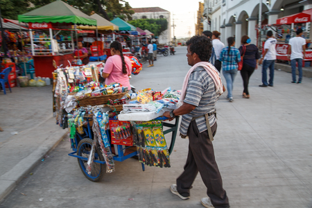 creole: Leon, Nicaragua, - December 14, 2015: man selling on the street Editorial