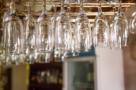 bar ware: Empty glasses hanging over in restaurant bar
