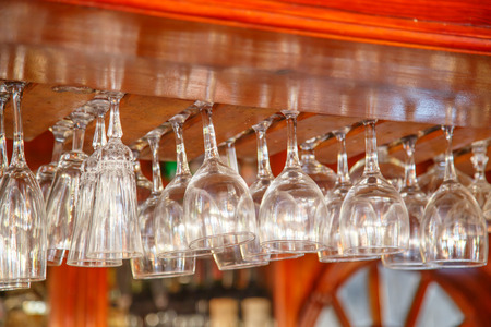 winy: Empty glasses hanging over in restaurant bar