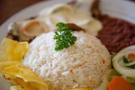 nicaraguan: rice with chicken, beans and salad from Nicaraguan cuisine Stock Photo