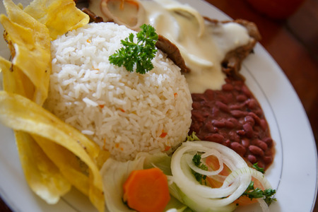 rice with chicken, beans and salad from Nicaraguan cuisine Stock Photo