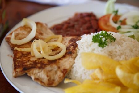 rice with chicken, beans and salad from Nicaraguan cuisine Imagens