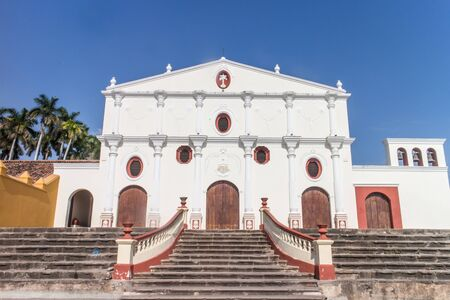 stucco facade: GRANADA, NICARAGUA: Facade of white stucco Spanish colonial church with grand staircase leading up to door