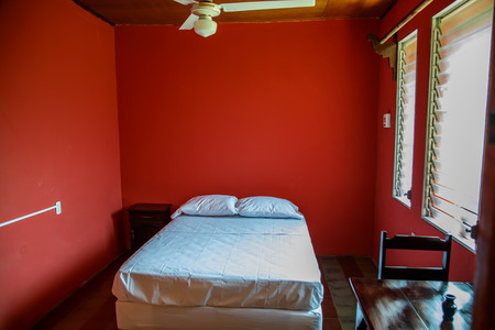 Hostel room with red wall