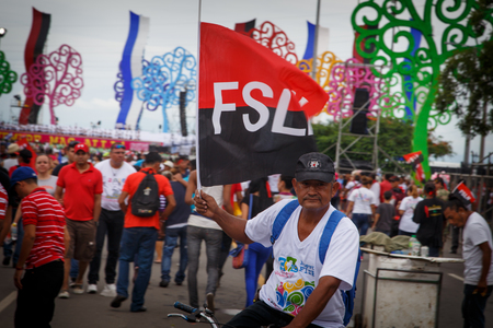 Managua, Nicaragua – July 19, 2016: People on street commemorating the 37th anniversary of victory of sandinist revolution Editorial