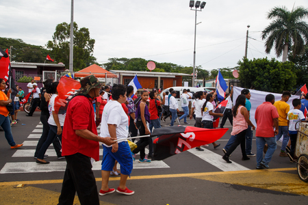 insurrection: Managua, Nicaragua – July 19, 2016: People on street commemorating the 37th anniversary of victory of sandinist revolution Editorial