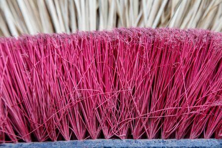 Broom of straw and new broom closeup