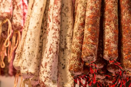 josep: Catalan dry sausages called fuet at Mercat de Sant Josep de la Boqueria market in Barcelona Stock Photo