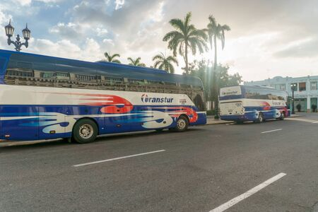 truck driver: CIENFUEGOS, CUBA - DECEMBER 31, 2016: Transtur bus in central park, Tourist transport Agency. Cuba Editorial
