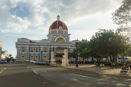 CIENFUEGOS, CUBA - DECEMBER 31, 2016: Central park view, with central comunist party executive building . Editorial