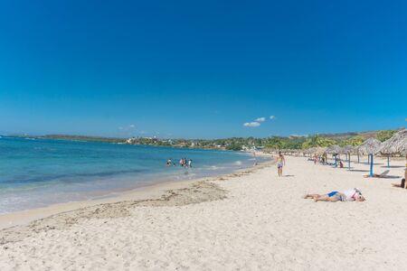 Cienfuegos, Cuba – January 1, 2017: Caribbean beach Playa Rancho Luna in Cienfuegos. Sandy coast