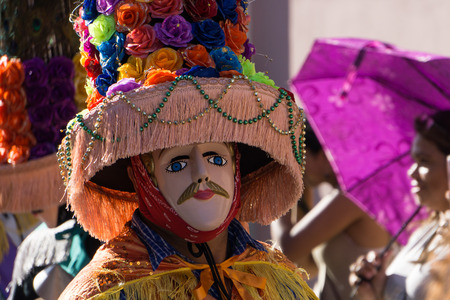 Granada, Nicaragua – February 15, 2017:  People wearing traditional dress and colorful masks during celebration of Carnival. Nicaragua traditional folk