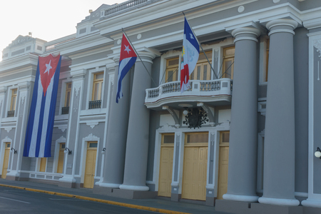 cienfuegos, cuba. City Hall with cuban and part Flags on facade during celebration of 1 january. Editorial